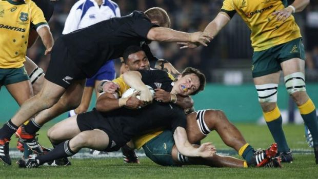 Stopped in his tracks: Wycliff Palu tackles New Zealand fullback Ben Smith during the All Blacks' one-sided Bledisloe ...