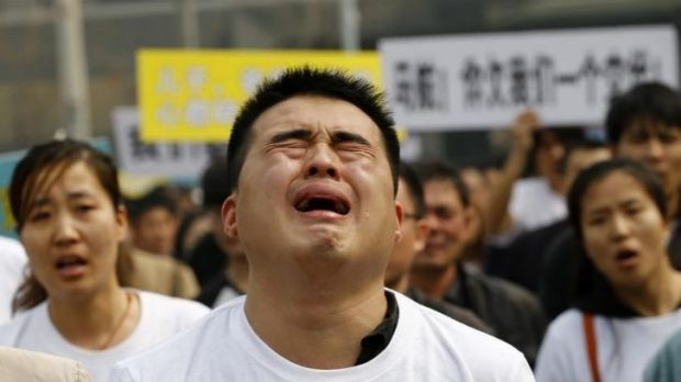 No end to the grief: A family member of a passenger on board Malaysia Airlines MH370 cries as he shouts slogans during a ...