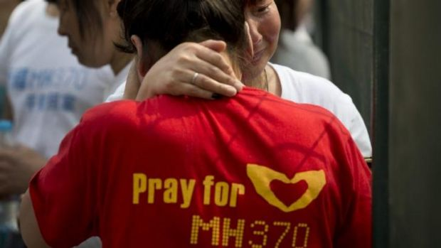The search goes on: MH370 relatives outside the Malaysia embassy in Beijing in April.