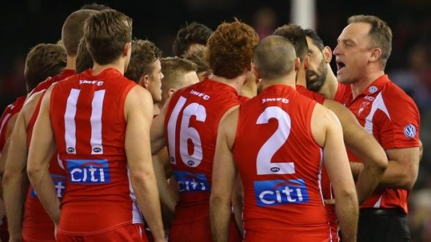 Listen to me: John Longmire talks to the Sydney players during Sunday's game.