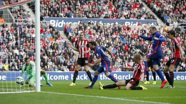 Manchester United's Juan Mata scores against Sunderland at the Stadium of Light on Sunday.