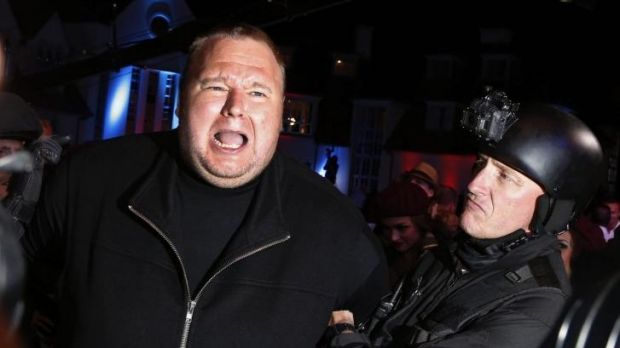 Publicity stunts: An actor in police costume mock-arrests Kim Dotcom during a press launch for Megaupload.