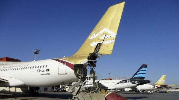 A damaged aircraft is pictured after shelling at Tripoli International Airport.