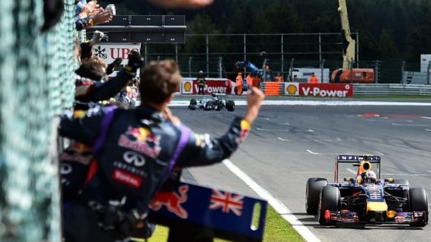 Daniel Ricciardo takes the the chequered flag for his third Grand Prix win.