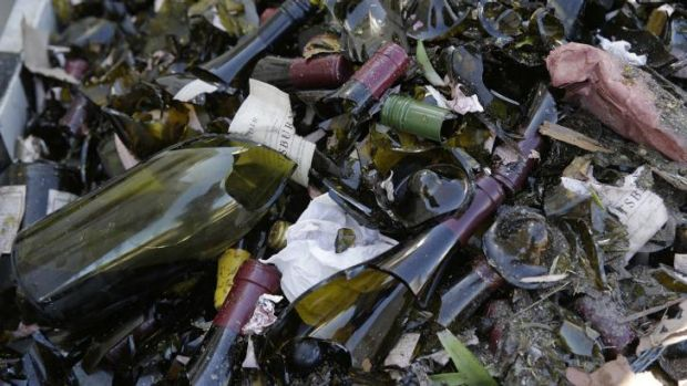Broken bottles from the library wines of Saintsbury winery fill a grape bin.