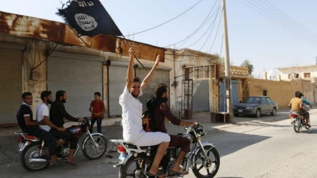 A resident of Tabqa celebrates after Islamic State militants took over the airbase.