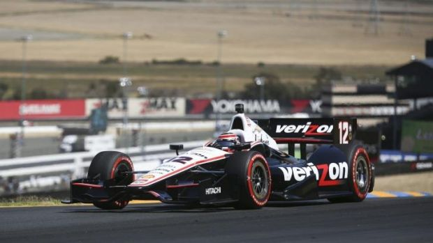 Will Power leads the way at the third turn in the IndyCar race on Sunday.