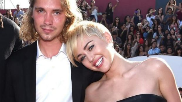 Triumph: Miley Cyrus with her mystery date, Jesse.