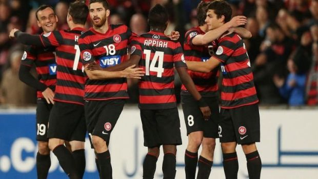 Expecting a frosty reception: The Wanderers celebrate their first leg win.