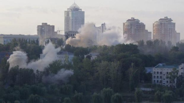Smoke billows over a residential apartment houses following shelling in Donetsk