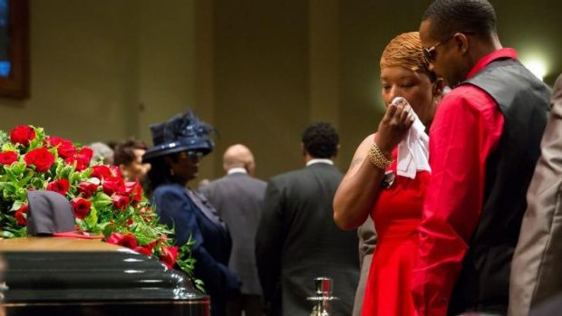 Heartbroken: Lesley McSpadden stands before the casket of her son Michael Brown during his funeral service at Friendly ...
