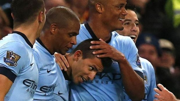 Manchester City's Sergio Aguero (C) celebrates with team mates after scoring.