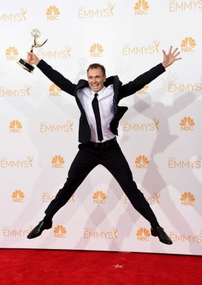 <i>The Amazing Race</i> host Phil Keoghan with the Emmy for outstanding reality - competition program.