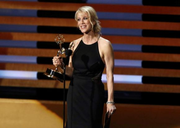 <I>Breaking Bad</I> star Anna Gunn accepts the Emmy for outstanding supporting actress in a drama series.