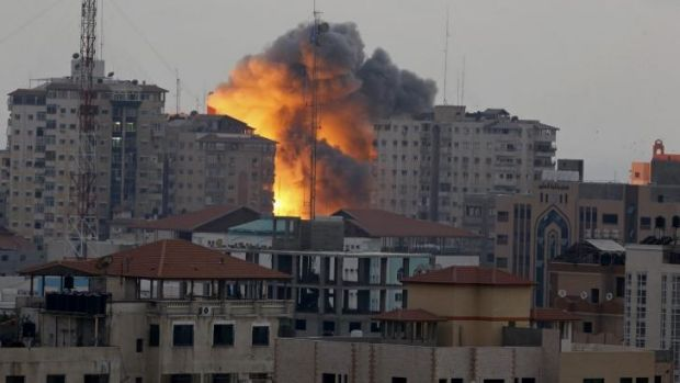 A ball of fire rises in Gaza City following an Israeli air strike on Saturday.