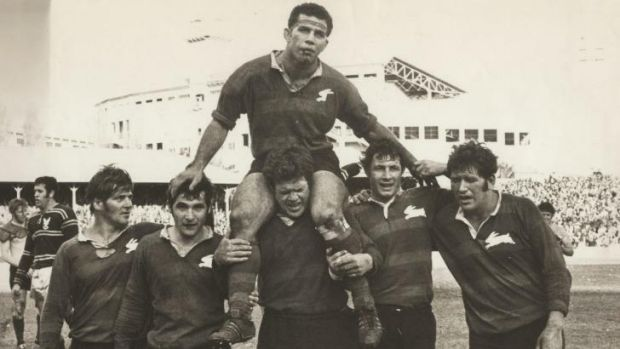 Brave bunny ... John Sattler is chaired from the ground by teammates after breaking his jaw in the 1970 grand final.