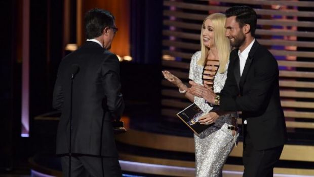 Woops: Gwen Stefani and Adam Levine present Stephen Colbert with his Emmy.