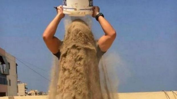 A man raises awareness of the Gaza conflict by taking the 'rubble bucket challenge'.