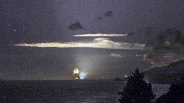 The horizon from Cape Greville in Chiniak, Alaska, after a rocket carrying an experimental Army strike weapon exploded ...