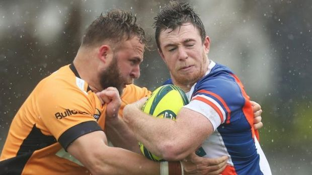 Ram jam ... Jed Holloway of the Rams is tackled by Ryan Dalziel of the Eagles during the round one National Rugby ...