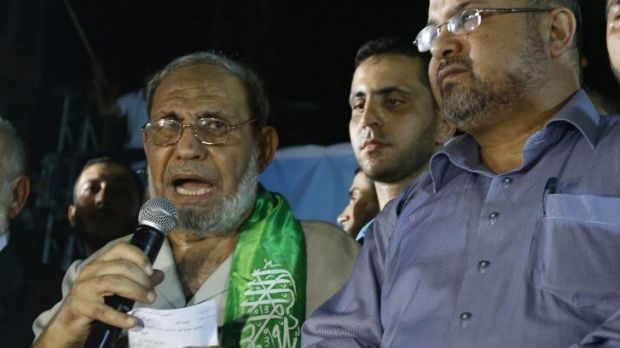 Senior Hamas leader Mahmoud Al-Zahar (left), appears for the first time since the start of the seven-week conflict at a ...