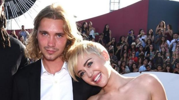 Wanted by police ... Friend's Place representative Jesse Helt, and singer Miley Cyrus attend the 2014 MTV Video Music ...
