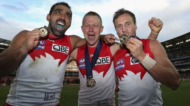 Grand champs ... Ryan O'Keefe, centre, celebrates with Adam Goodes and Jude Bolton after winning the 2012 grand final