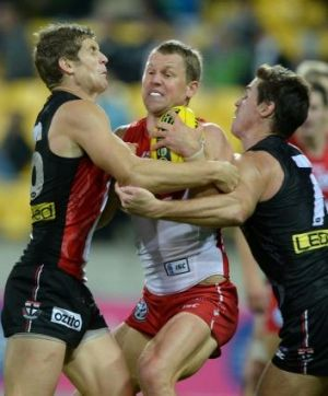 Lenny Hayes, right, in familiar action for St Kilda.