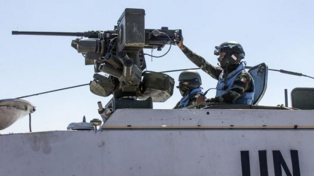 Irish members of the United Nations Disengagement Observer Force in armoured vehicles in the Israeli-annexed Golan Heights.