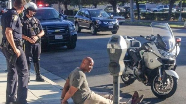 Beverly Hills police handcuffed and arrested producer Charles Belk after he 'fit the description' of a bank robber.