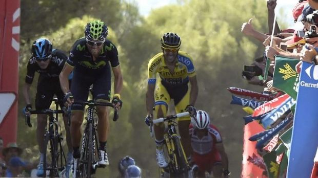 Alejandro Valverde leads a star-studded sprint ahead of former Tour de France champions Chris Froome (L) and Alberto ...
