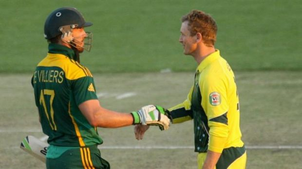 Australia captain George Bailey (right) concedes defeat to South Africa captain A B de Villiers during their match in ...