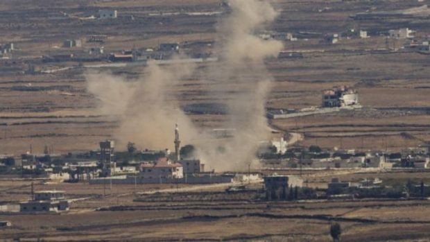 Smoke rises following an explosion in Syria's Quneitra province as rebels clashed with President Bashar al-Assad's ...