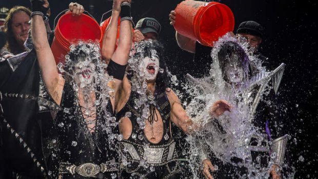 Members of the band KISS get doused for the ALS Ice Bucket Challenge.