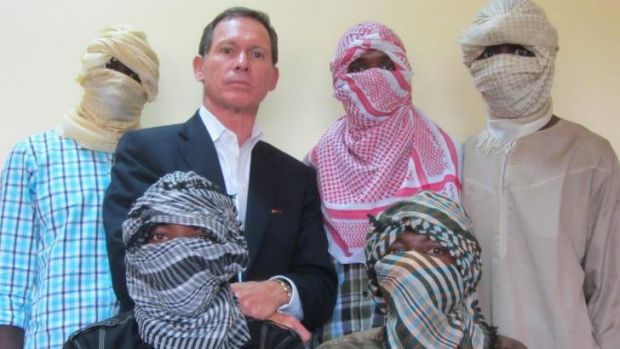 Stephen Davis last year with members of the terror group JAS, a forerunner to Boko Haram.