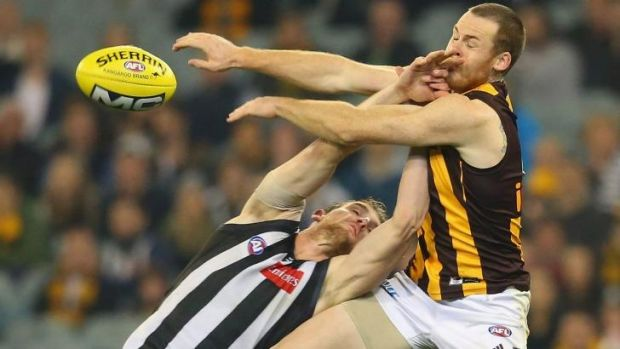 Hawthorn's Jarryd Roughead attempts to mark over  Lachlan Keeffe of Collingwood.