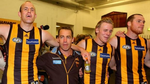 Alastair Clarkson (second from left) joins his team in the rooms to sing the club song.