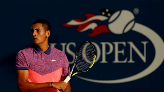 Nick Kyrgios returns a shot against Andreas Seppi.