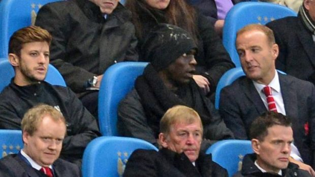 New challenge: Mario Balotelli in the stands at Liverpool's loss to Manchester City.