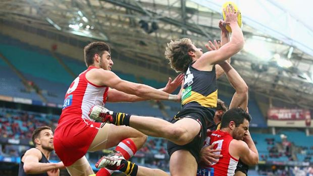 Tigers soar .... Ben Griffiths marks strongly in their remarkable three-point win. <b><a ...