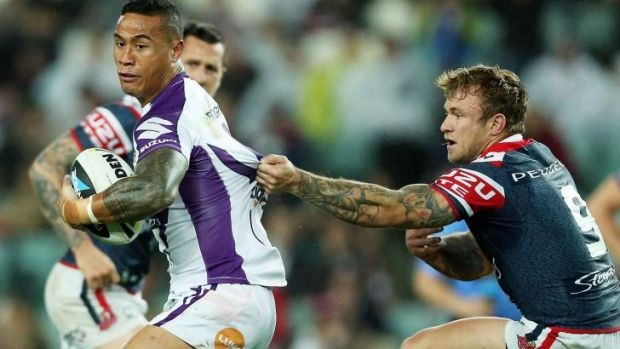 Come back here: Ben Roberts of the Storm is tackled by Jake Friend of the Roosters.