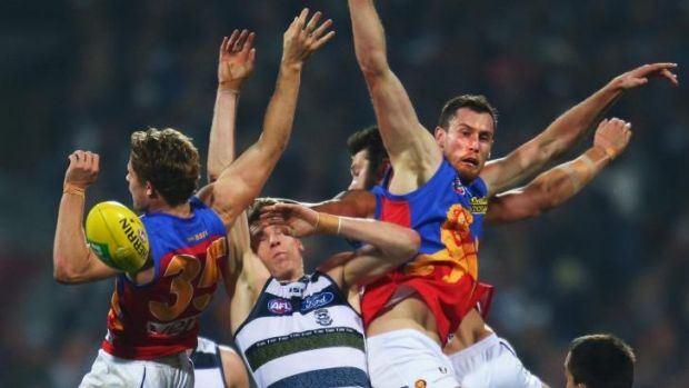 Under pressure: Mark Blicavs gets swamped by Brisbane opponents.