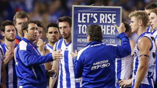 Game plan: North Melbourne coach Brad Scott gives his Kangaroos instructions on how to stay on top of Melbourne.