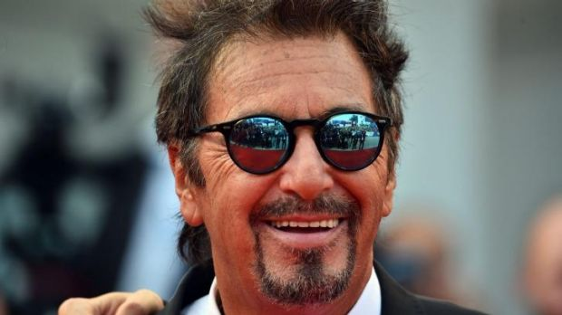 Star power: A tanned Al Pacino, 74, on the red carpet at Venice with his vigorously gelled hair and blue mirror shades.