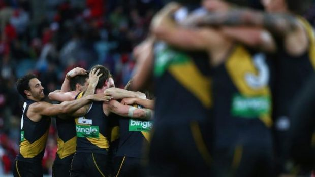 The Tigers celebrate victory over the Swans.