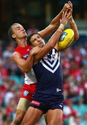 Ted Richards battles with Matthew Pavlich in round five.