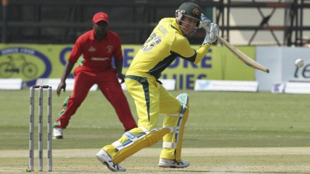 Injured again: Michael Clarke drives on the off side before retiring hurt.