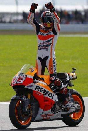 Honda MotoGP rider Marc Marquez of Spain celebrates after winning the British Grand Prix at the Silverstone Race Circuit ...
