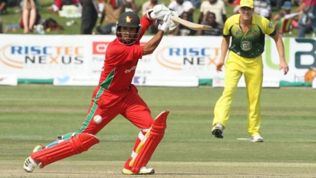 On the front foot: Zimbabwean batsman Sikandar Raza sends one to the boundary.