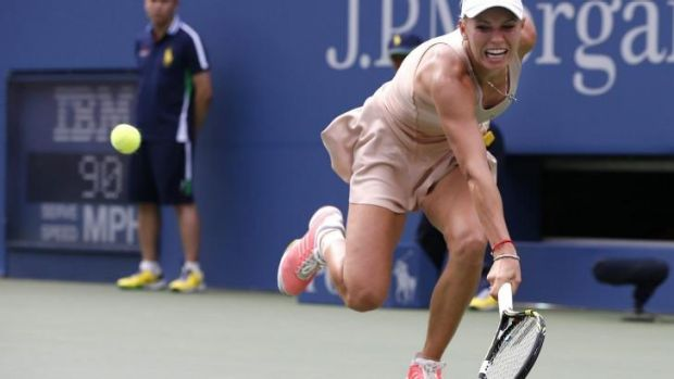 Groundstroke marathon: Caroline Wozniacki stretches to return a backhand.
